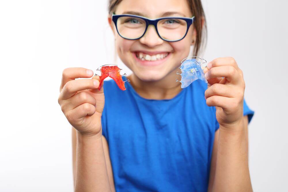 What does an orthodontist do